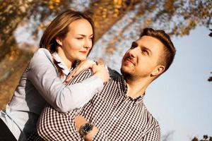 Romantic couple in autumn park - love, relationship and dating concept photo