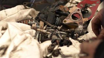 Car Master Checks Screws During Car Repair video