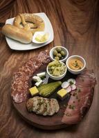 german cold cuts tapas snack platter with meats and bread photo