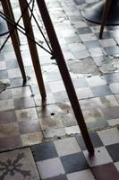 traditional design old rustic floor tiles detail in spanish cafe photo
