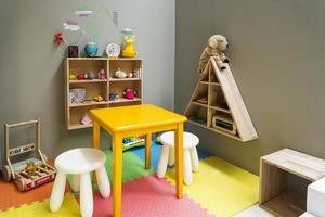 children play area with toys and furniture photo