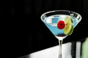 blue curacao cocktail with cherry and lime photo