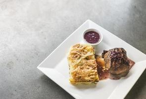 roast beef with potato cheese bake and beetroot sauce photo