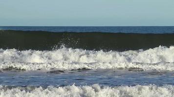 Ocean wave crashing on sandy shore. video