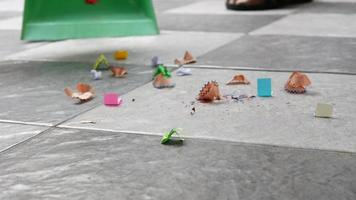 Sweep up scraps of paper and dust on tile floors with a broom. video