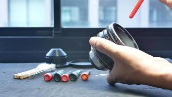 Blowing dust to clean the glass of movie shooting lenses. video