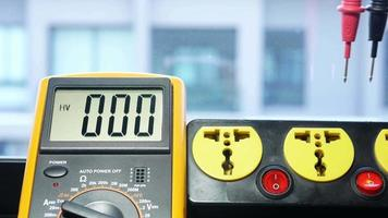 Measure the AC voltage from the power outlet with a digital meter. video