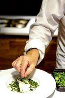 chef cooking, Chef preparing food, Chef decorating dish in the kitchen photo