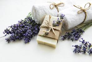 Spa setting with natural soap, towels and lavender photo
