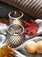 Knitted sweaters and candles photo