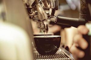 espresso shot from coffee machine in coffee shop photo
