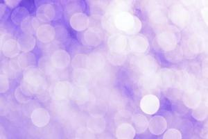 Bright purple blurred bokeh background with highlights photo