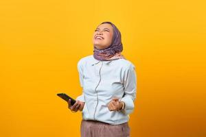Angry Asian woman holding mobile phone getting bad news photo
