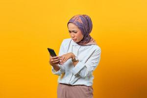 Sadness Asian woman looking at smartphone getting bad news photo
