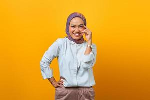Portrait of confident Asian woman raised hands with smiling face photo