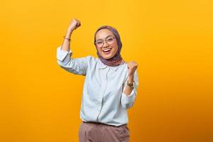 Portrait of cheerful Asian woman rejoicing celebrating luck photo