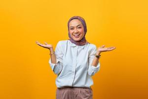 Portrait of cheerful Asian woman with confident expression photo