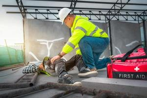 Accident at construction site. Physical injury at work. photo