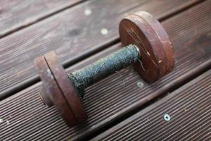 heavy steel dumbbell, handle rewound with black duct tape photo