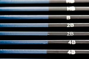 Full set of black and blue pencils sorting from dark to light. photo