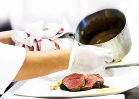 Chef preparing food in the kitchen, chef cooking, Chef decorating dish photo