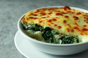 Spinach lasagna with cheese Italian food style , Vegetarian lasagna photo