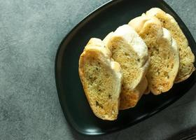 Garlic and herb bread slices on the table, Tasty bread with garlic photo