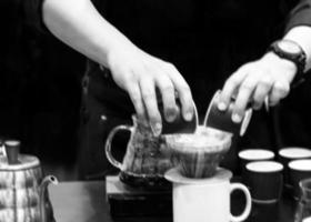 Motion blur Barista is making coffee, Dripping hot fresh coffee photo