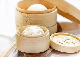 Chinese steamed pork buns, Steamed bun served in wooden basket photo