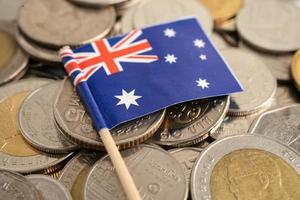 New Zealand flag on coins background photo