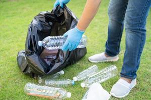 Asian woman volunteer carry water plastic bottles photo