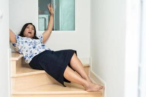 Asia woman fall down the stairs because slippery surfaces photo