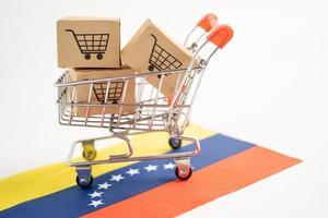 caja con logo de carrito de compras y bandera de venezuela foto