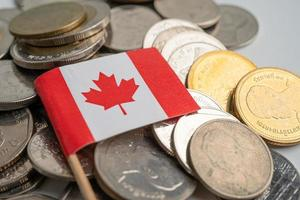 Canada flag on coins background photo