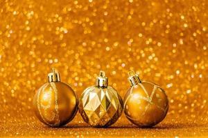 Christmas balls on shiny gold background. photo
