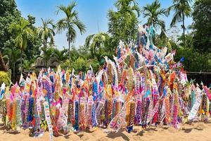 Paper flag on Sand pagoda in Songkran Festival Chiang Mai, Thailand. photo
