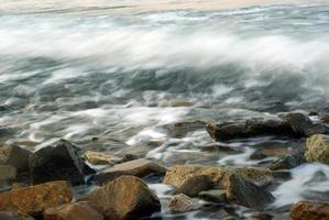 Turbulence sea water and rock at Coastline photo
