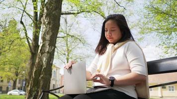 Asian woman finish work on laptop and taking a break video