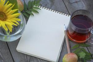Blank notepad on a wooden table, place for text. photo