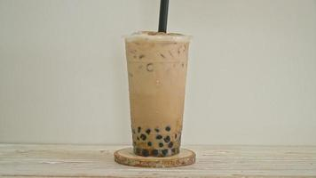 Taiwan milk tea with bubble and cheese burned on wood table video