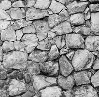 Textura del antiguo muro de piedra del castillo foto