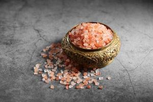 Himalayan pink salt in golden cup at loft kitchen photo