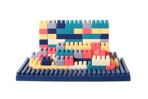 Small plastic building blocks on white background photo
