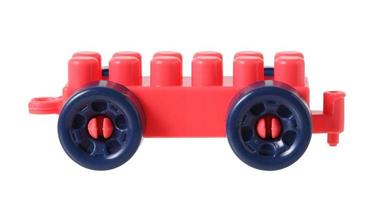 Small train from plastic blocks on white background photo