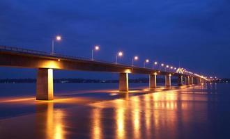 Concrete bridge and river in twilight photo