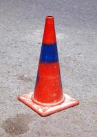Red and blue traffic cone on road photo
