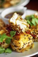 Close up Japanese tofu and sesame fried in ceramic dish photo