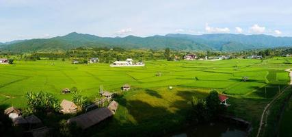 Green field landscape in rainy season beautiful village in the valley photo