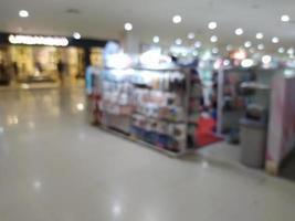 Desenfoque abstracto con bokeh en el centro comercial, supermercado fuera de foco foto