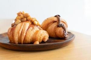 Homemade croissant on wooden table in kitchen prepare for breakfast photo